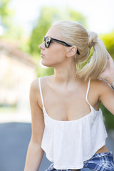 Casual blonde girl with sunglasses in the sun