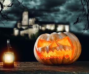 Halloween pumpkin on wood with dark background