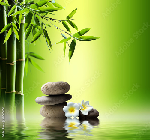 Leinwandbild Motiv spa background with bamboo and stones on water