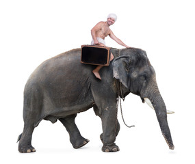 happy mahout rides on an elephant carrying a suitcase