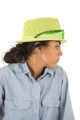 Asian teen looking sideways wearing a green hat