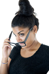 Attractive South Asian teen girl removing her big black glasses