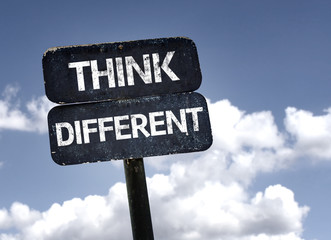 Think Different sign with clouds and sky background