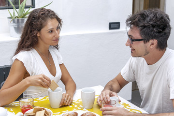 teenage couple has breakfast at home