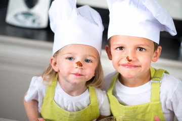 happy children kids family preparing funny cake kitchen at home