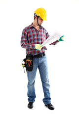 Male construction worker examining blueprint