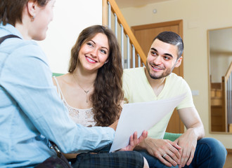 Young couple with insurance agent