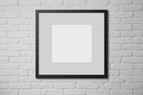 Blank picture frame at the brick wall with copy space and clippi