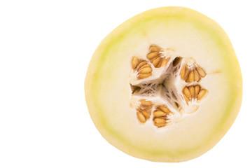 Slice of honeydew fruit over white background