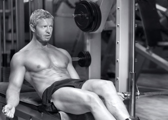 Handsome fitness model in black and white
