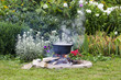 Black pot in garden camp fire - 69065475