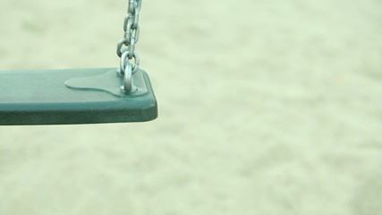 Happy childhood. Empty chain swing on playground. Full HD