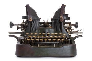 Antique typewriter against a crisp white backdrop.
