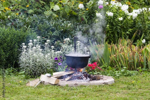 Foto op Aluminium Picknick Black pot in garden camp fire