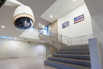 CCTV Camera Operating in side building with doors and stairs