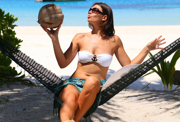 girl in hammock on the beach