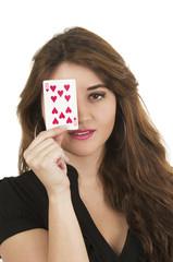 Beuatiful young woman playing cards