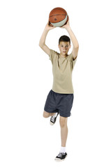 Young man jumping and throwing a ball