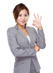 Business woman hand with ok sign