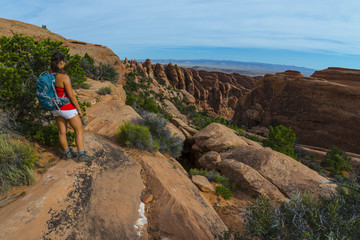 Female hiker stading on a Devils Garden trail