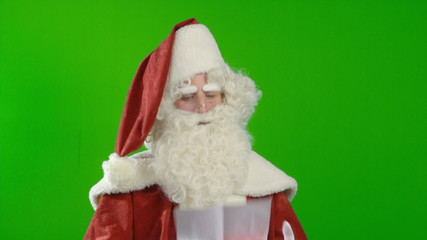 Santa Claus Reading a Wish List and Agrees to the Wish