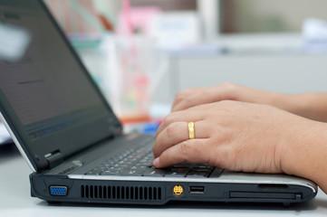 Close-up of typing businesswomen