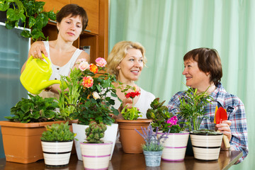 women and girl taking care of  plants