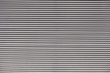 gray metal witl parallel lines background