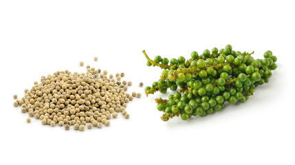 peppercorn and Bunches of fresh green pepper isolated on white b