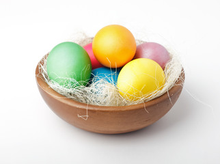 Colorful painted easter eggs in bowl