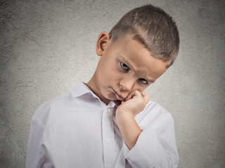 Sad Depressed tired Child, isolated on grey wall background