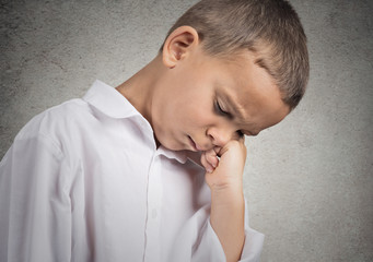 Portrait Sad Depressed Tired Child on grey wall background