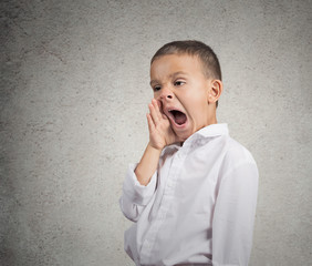 Portrait Tired Child Yawning isolated on grey wall background
