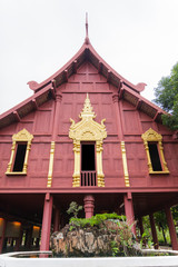 traditionally thai architecture house with fountain