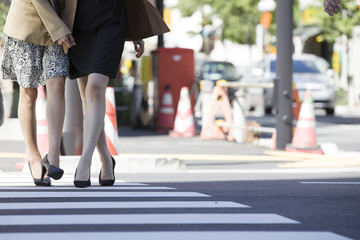 Women across the crosswalk with a friend