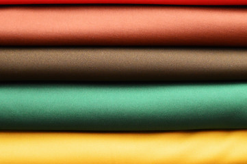 stack of colourful folded fabric for use in sewing clothing