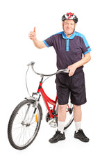 Mature man with a bike giving a thumb up