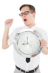 Nerdy businessman showing clock to camera