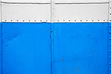 close up old blue and white metal wall