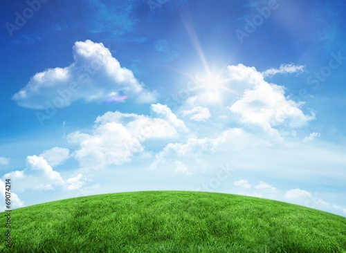 Green hill under blue sky - 69074214