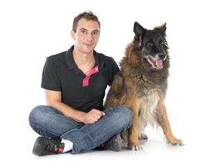 old belgian shepherd and man