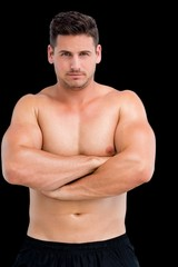 Portrait of a shirtless muscular man with arms crossed