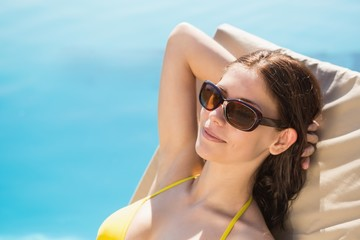Cheerful woman by swimming pool