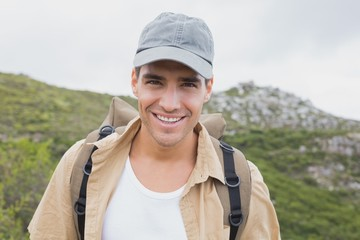 Close up portrait of a happy hiking man