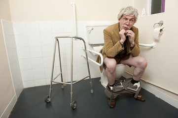 Old Man On Toilet