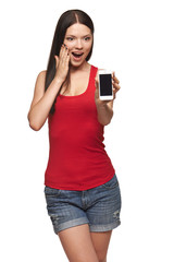 Excited surprised woman showing cell phone