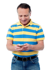 Casual aged man using mobile phone
