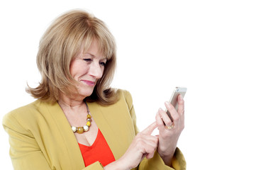 Senior woman looking at her cell phone