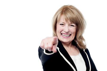 Senior woman pointing finger