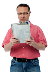 Casual senior man reading a book